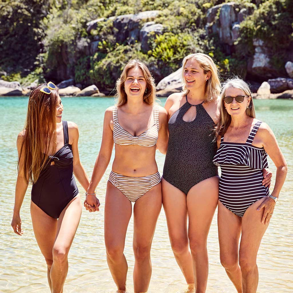 beautiful group of women supporting women at the beach in their contessa volpi swimwear