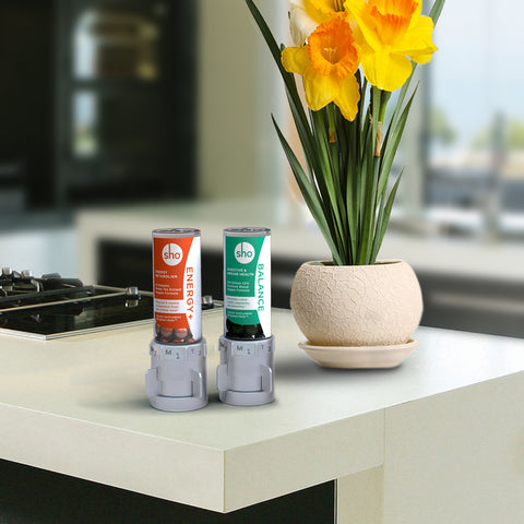 sho Energy+ and sho Balance supplements on kitchen countertop