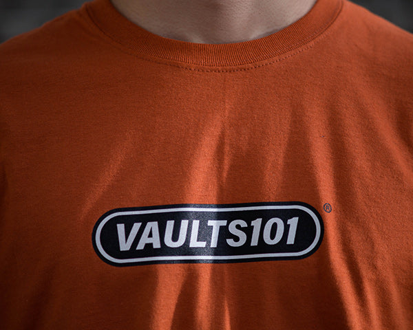 Vaults101®︎ 2nd drop Texas orange logo