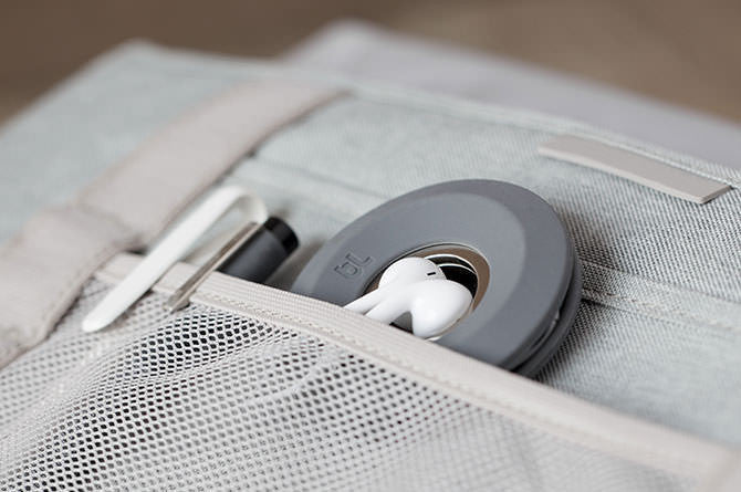 Cableyoyo keeps earbuds tidy and tangle-free in a neat little spool.