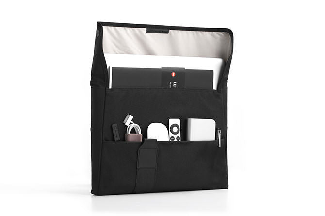 The main compartment holds the laptop with pockets for peripheral cables