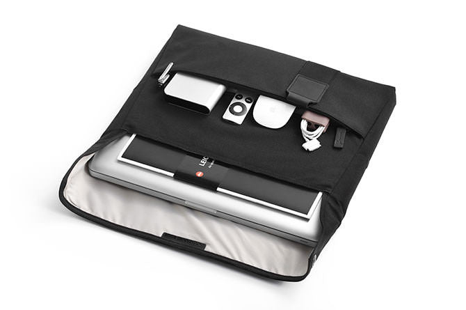 The Laptop Sleeve keeps smaller items organized and your laptop stowed away safely