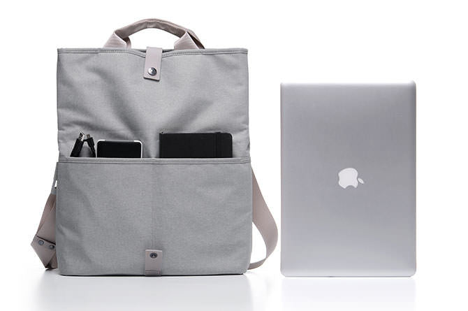 "When expanded and carried as a top handle bag, the Postal Bag can fit at 15"" MacBook Pro"