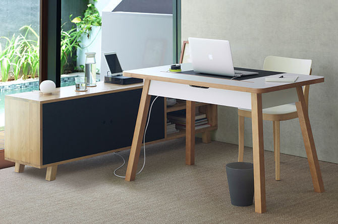 StudioDesk is a table-style desk that stores cable clutter, adapters and messes beneath the desktop for a spotless workspace.