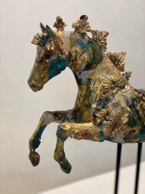 Gold and turquoise blue carousel horse sculpture on a wire frame by April Young at Iona House Gallery