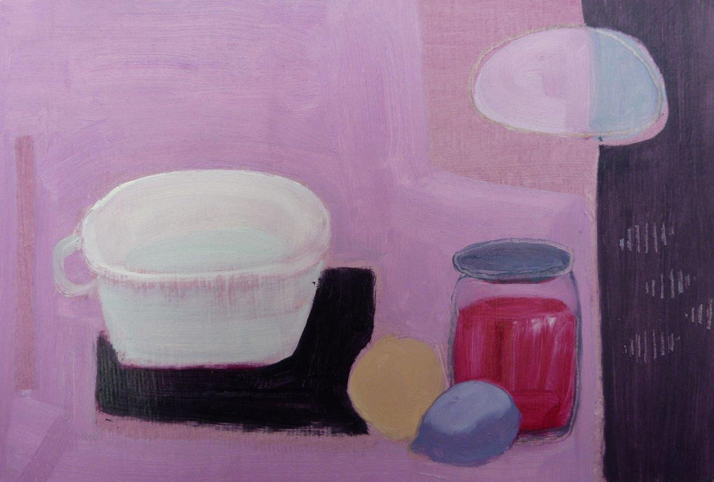 Still life with white cup, jar of jam and sliced up lemon. Pale pink background with purple stripe on right hand side