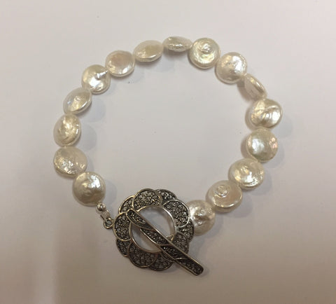 Pearl and antique flower clasp bracelet