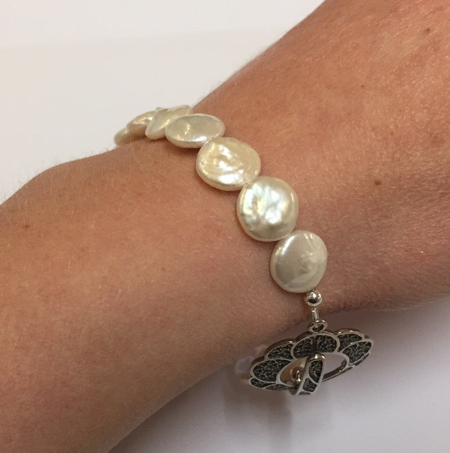 Pearl and antique sterling silver clasp bracelet