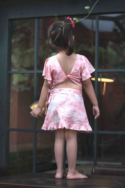 Little girl in pink skirt and top set made with organic cotton and natural dye.