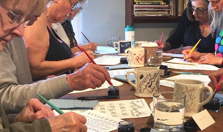 A Beginner Copperplate Calligraphy Workshop in full concentration practicing their strokes.