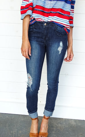MID-RISE DISTRESSED SKINNIES