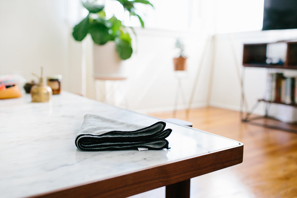 A clean living room with a microfiber cloth.