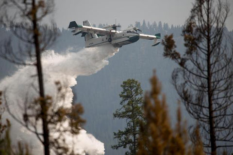 An air tanker drops water on the Rice Ridge Fire near Seeley Lake, Montana, Aug. 2 2017