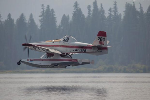A single engine air tanker loads water at Seeley Lake