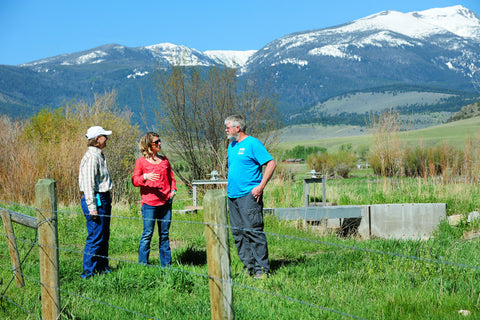 Sunni Heikes-Knapton (center), the watershed coordinator for the Madison Conservation District in Montana, discusses irrigation and habitat improvements with Janet Endecott and Pat Clancey, a fisheries biologist with Montana Fish, Wildlife and Parks, on Endecott's ranch in McAllister, Montana. Photo credit: Eliza Wiley.