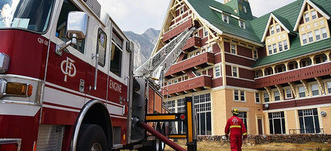 Charred grounds around the Prince of Wales Hotel at Waterton Lake, on the north side of Glacier National Park. fire truck ladder