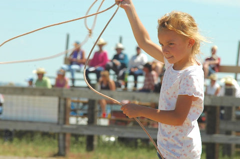 girl twirls rope at custer ranch rodeo in custer, montana, montana living cowboys and cowgirls