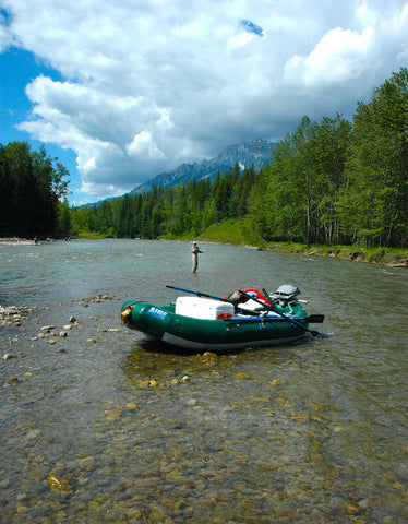 rafting, floating, john hollensteiner holds a cutthroat trout on the elk river in Fernie, British Columbia. David Reese photo, Montana Living