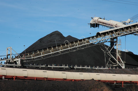 Coal is loaded on a conveyor at a coal mine in Colstrip, Mont. David Reese photo