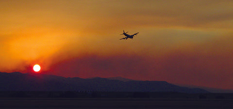 plane flying over forest fire, smoky sunset, fires in the west, montana living, university of montana philip higuera