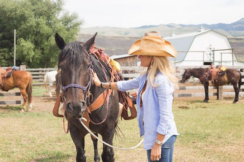 arthur m blank foundation, AMB basecamp, montana living, woman with horse at montana ranch