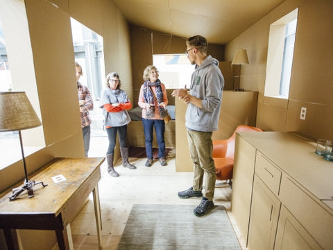 Montana State University architecture student Tanner Houselog, right, speaks with guests about the full scale prototype shelter for the research on homelessness in Bozeman, Mont., on Thursday, Nov, 17, 2016, by architecture students in preparation for an open house event on Tuesday, Nov. 29, 2016, to showcase to the community and receive feedback on their project. MSU Photo by Adrian Sanchez-Gonzalez