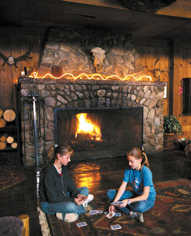 A family enjoys the big fireplace at Jackson Hot Springs, Montana. Michael Javorka photo