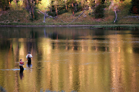 two flyfishers in river, fly fishing yellowstone national park, montana living