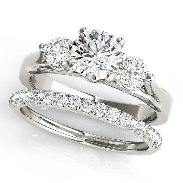 Three stone engagement ring and diamond wedding band may for Three stone wedding ring set
