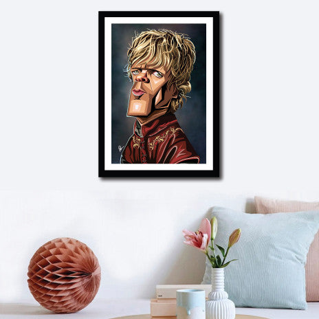 Framed Poster of TV Character Tyrion in caricature tribute art by Prasad Bhat. Image shows wall decor of the artwork, Artwork has him standing sideways and looking to the front. He is in his royal attire and with his golden hair looking grim.