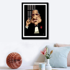 Framed Godfather Poster on a wall decor. Caricature Art by Prasad Bhat showing Don Corleone sitting in his iconic pose with a red pocket rose, his one hand held up and against a black backdrop.