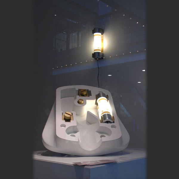 Fuse Lamp on display in The Three White Walls Gallery. Giant plug with Fuse Lamp installed also visible.