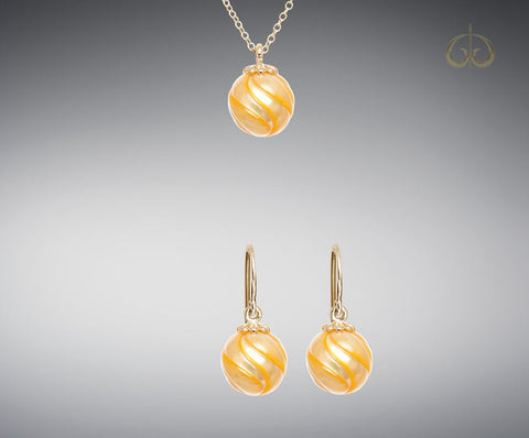 Galatea Carved Golden Pearl Earrings