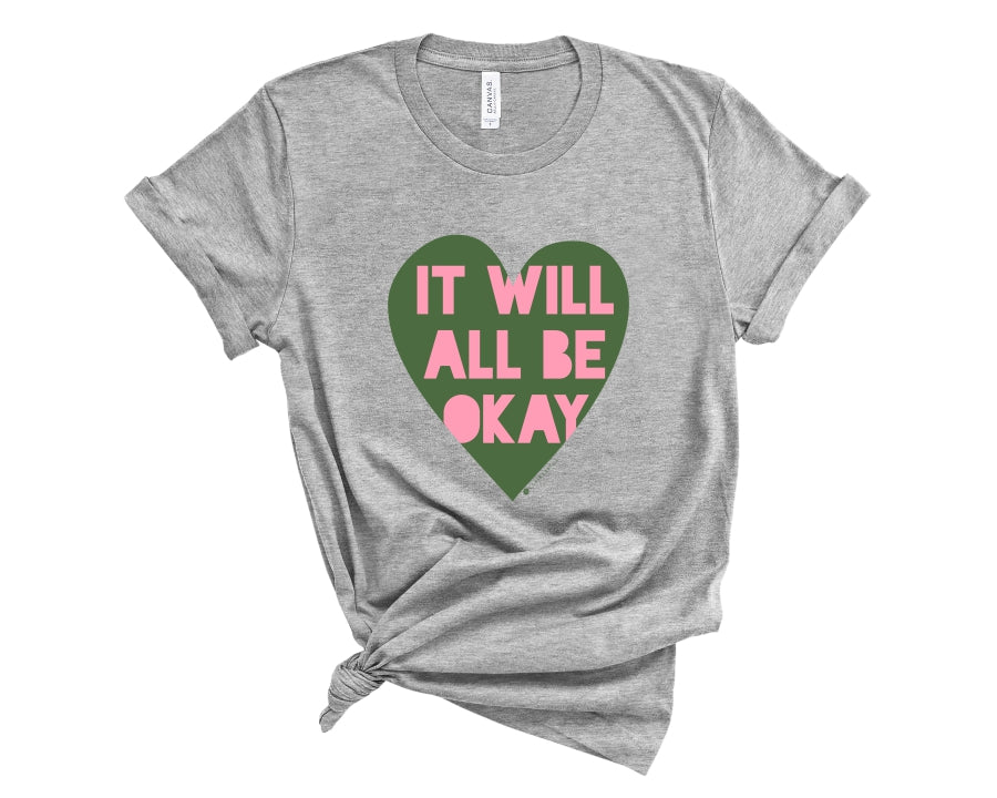 "Gray, crew neck t-shirt with ""It will all be okay"" in pink lettering over a green heart"