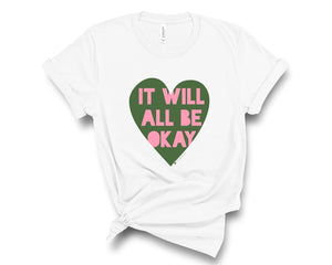 "White, crew neck t-shirt with ""It will all be okay"" in pink lettering over a green heart"