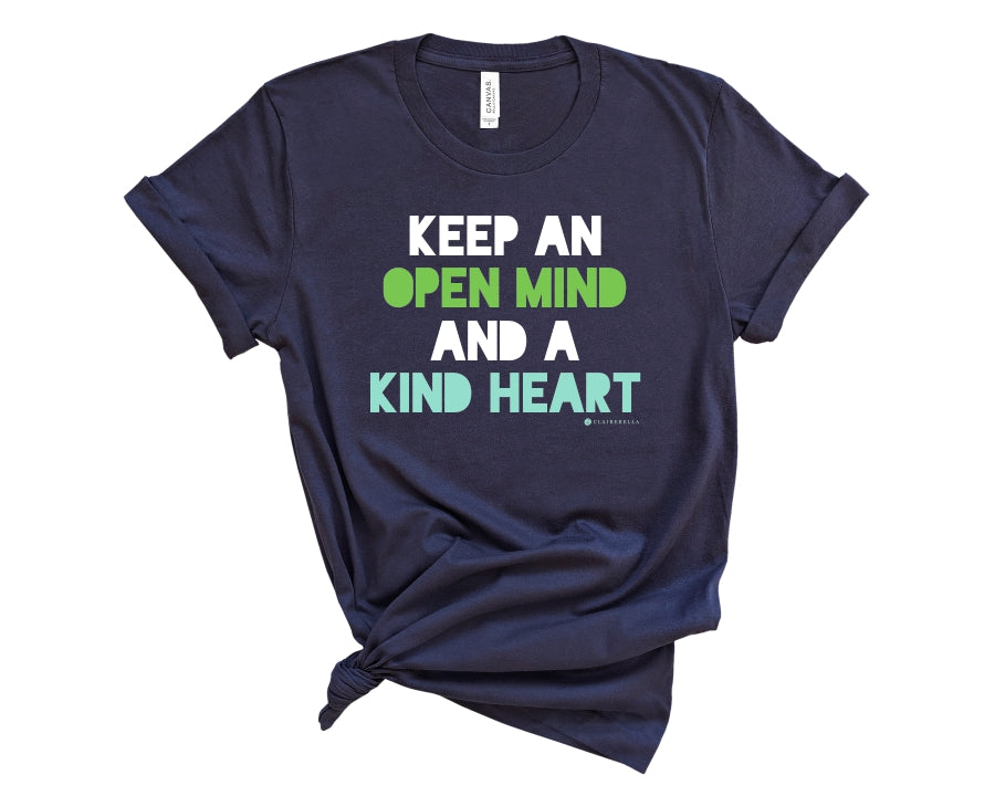 "Navy, crew neck t-shirt with ""Keep an open mind and a kind heart"" in white, green, and teal block lettering"