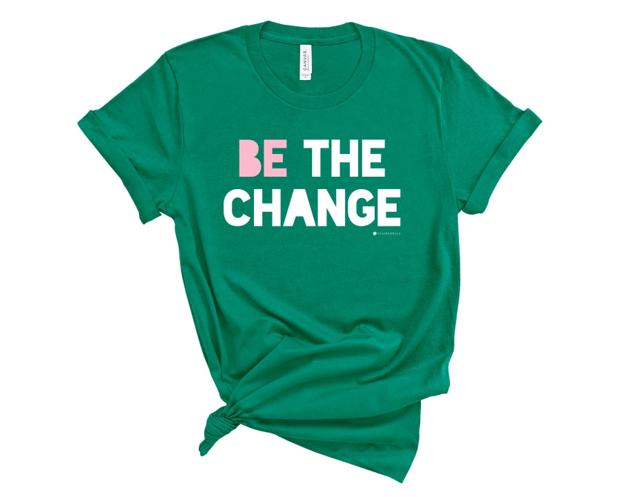 "Green, crew neck t-shirt with ""Be the change"" in white and pink block lettering"