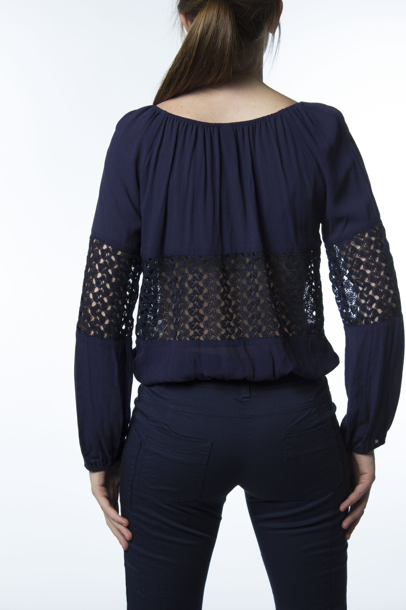 dark blue top with lace sheer panels