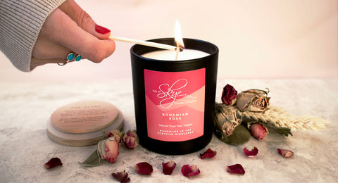 Ciora Isle of Skye Candle Bohemian Rose Woman lighting candle with match