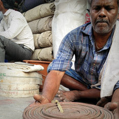 Jaggery Bags - Man Cleaning Fire Hose