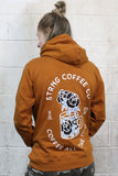 STRONG COFFEE unisex pullover hoodie brown leather view from the back woman