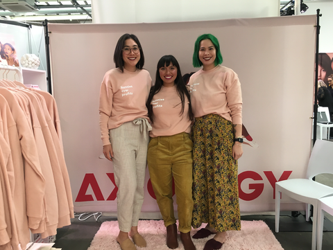 Ericka with members of the Axiology team at a pop-up event