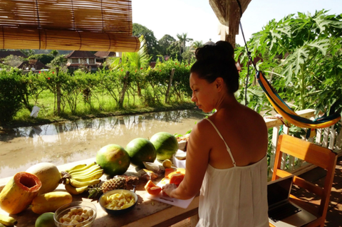 Axiology founder, Ericka Rodriguez, cutting fruit while living in Bali