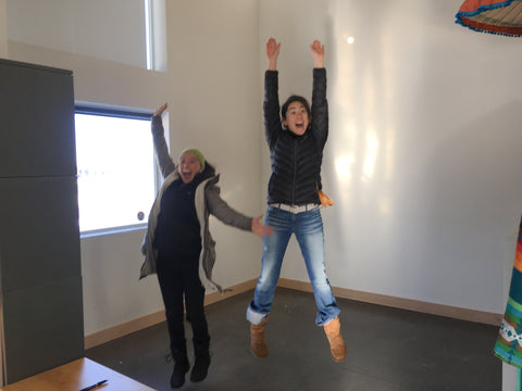 Ericka and Chloe jumping for joy in their first office apartment space