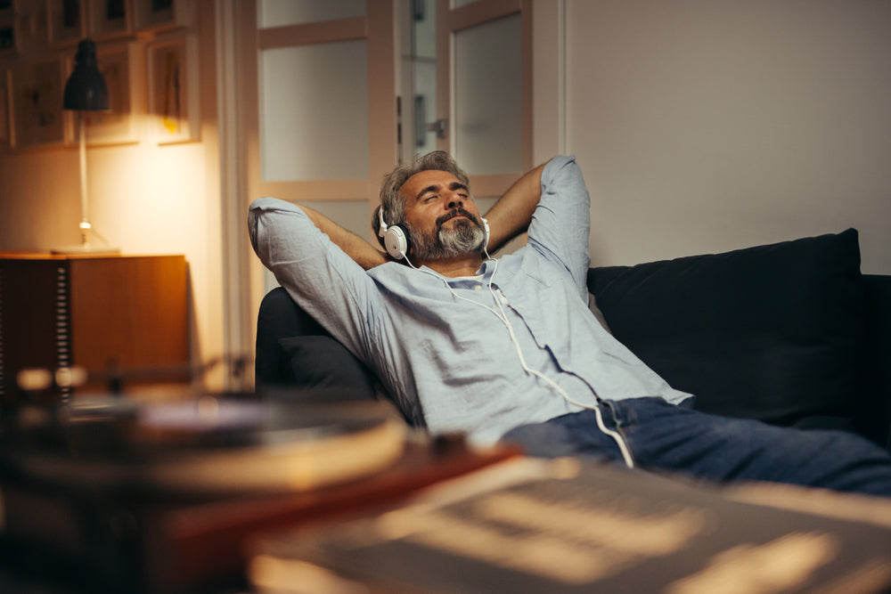 Man listening to music on couch