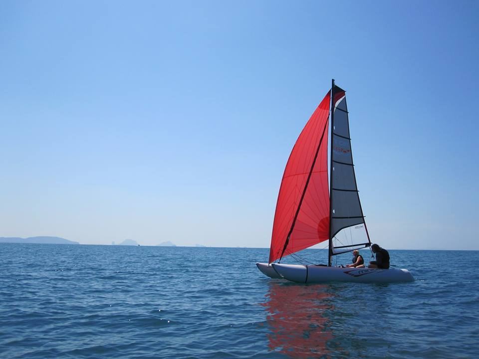 MiniCat 420 Inflatable Catamaran Sailing in Bay