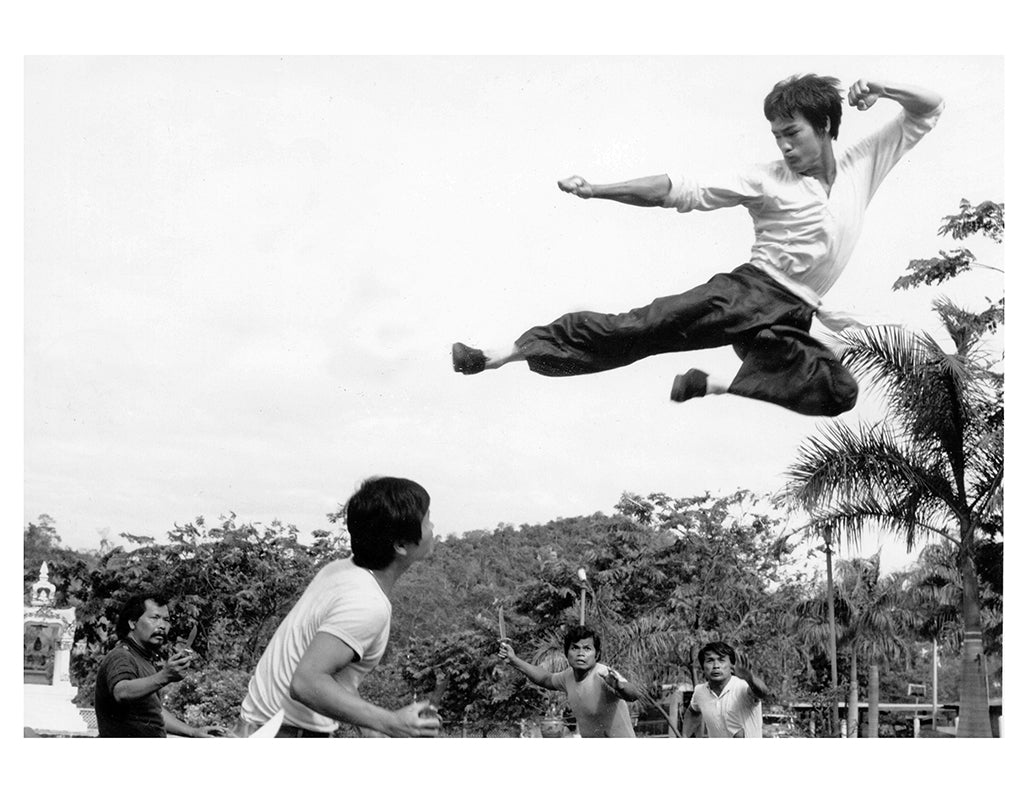 Bruce Lee performing a flying kick in the 1971 movie Big Boss