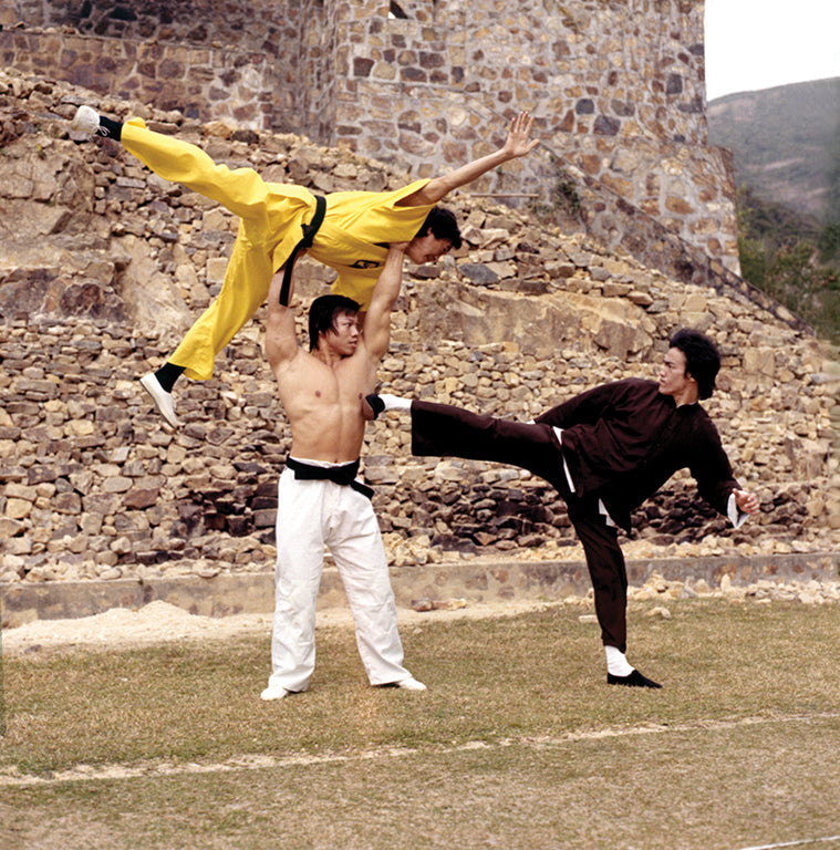 Bruce Lee kicking Bolo Yeung in the 1973 movie Enter the Dragon