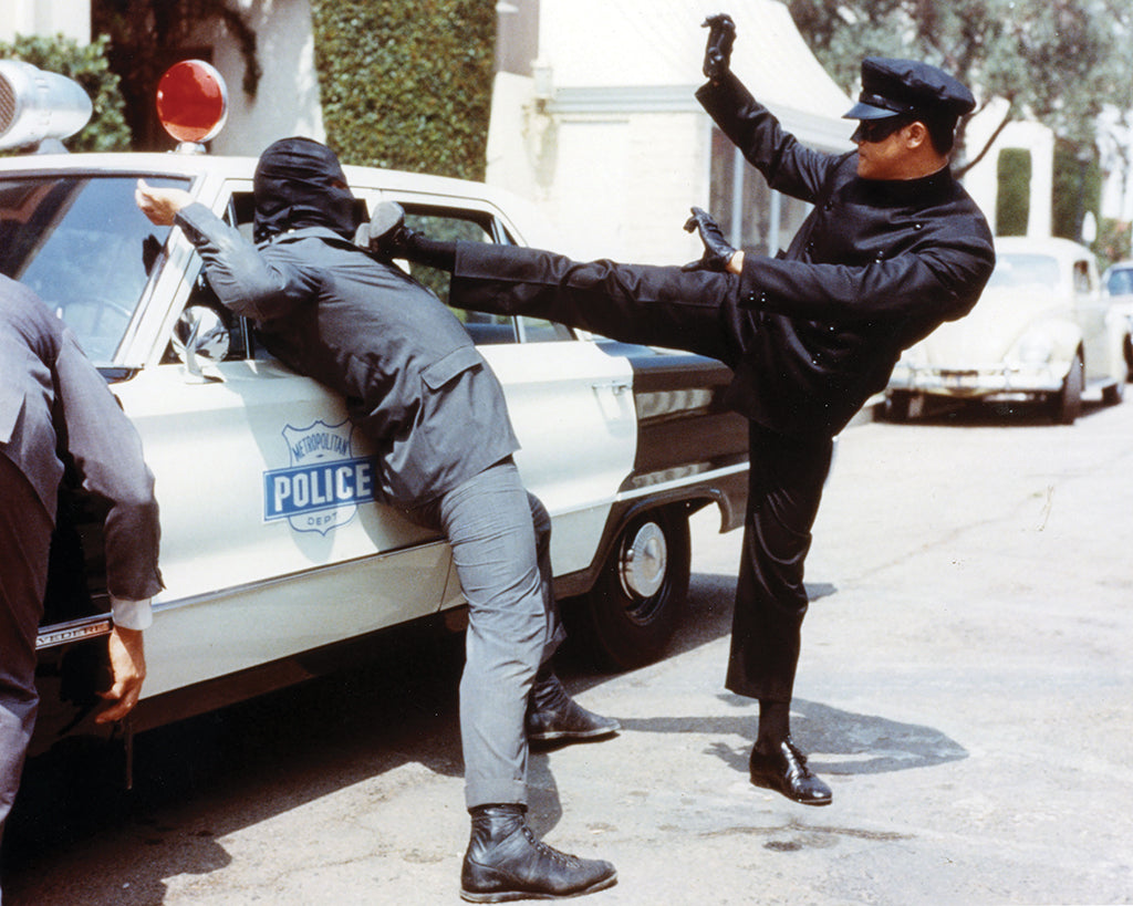 Bruce Lee as Kato kicking a criminal in Green Hornet circa 1966