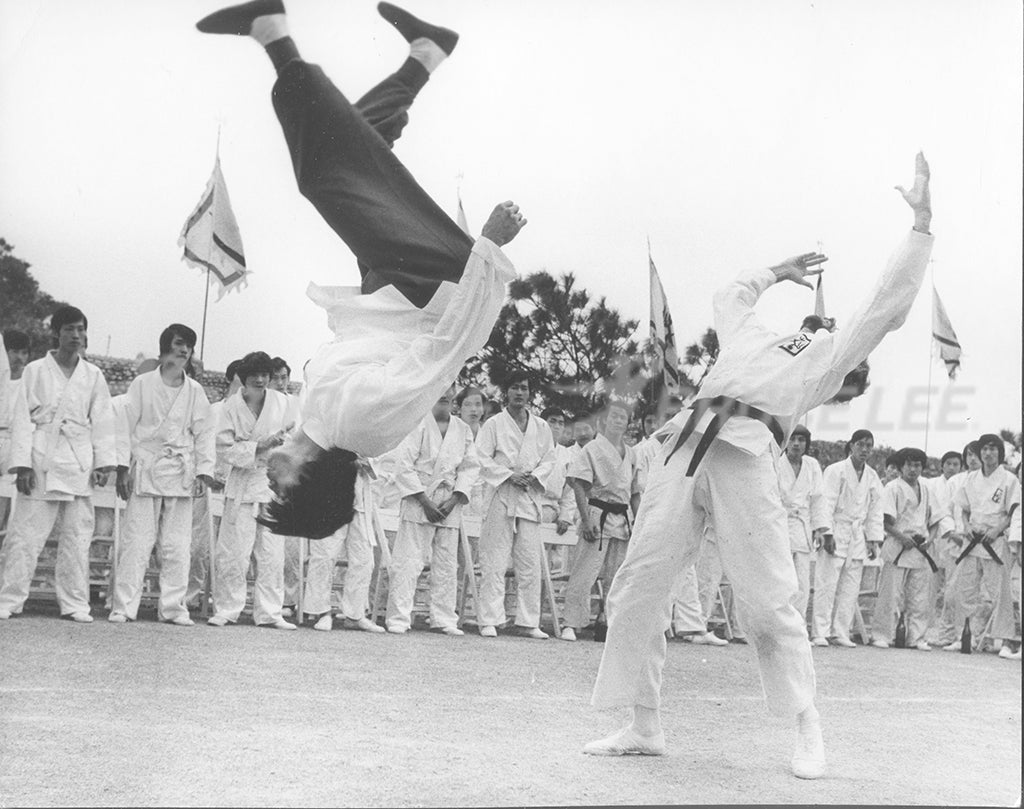 Bruce Lee performing a kick flip in the 1973 movie Enter the Dragon